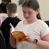 Morey Elementary School students pick out a free book each, ahead of spring break, through Reading is Fundamental. Fourth grader Alyssia Spencer, 9, picks out a book.  (SUN/Julia Malakie)
