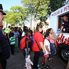 Back-to-school party for Lowell public schools at JFK Plaza. Lowell Police Sgt. Steve Morrill watches as officer Felix Gonzalez hands out ice cream. (SUN/Julia Malakie)