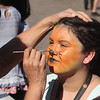 Back-to-school party for Lowell public schools at JFK Plaza. Kayliannah Rivera, 9, of Lowell, gets her face painted by early childhood coordinator Lisa Van Thiel. (SUN/Julia Malakie)