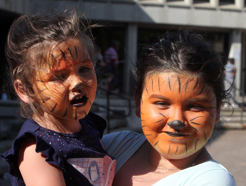 Back-to-school party for Lowell public schools at JFK Plaza. Skyannah Rivera, 2, and her sister Kayliannah Rivera, 9, of Lowell, after having their faces painted. (SUN/Julia Malakie)