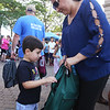 Back-to-school party for Lowell public schools at JFK Plaza. Gabriel Barbosa, 4, of Lowell, who's going into pre-K, and his mother Stella Barbosa, check out his new backpack. Backpacks were given out until they ran out. (SUN/Julia Malakie)