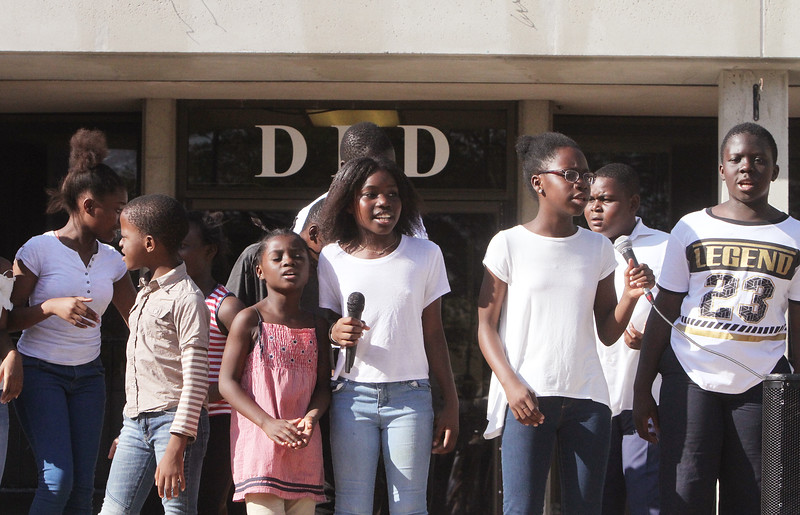 African Community Center group sings at back-to-school party for Lowell public schools at JFK Plaza. (SUN/Julia Malakie)