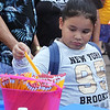 Back-to-school party for Lowell public schools at JFK Plaza. Genesis Alicea, 6, of Lowell, who's going into 1st grade, picks out a pencil. (SUN/Julia Malakie)