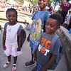 Back-to-school party for Lowell public schools at JFK Plaza. Ashasie Brefo, 9, center, and his brother Yentumi Brefo, 4, of Lowell, and their cousin Oheneafrewo Sarpong, 3, visiting from London, England, all got new backpacks. (SUN/Julia Malakie)