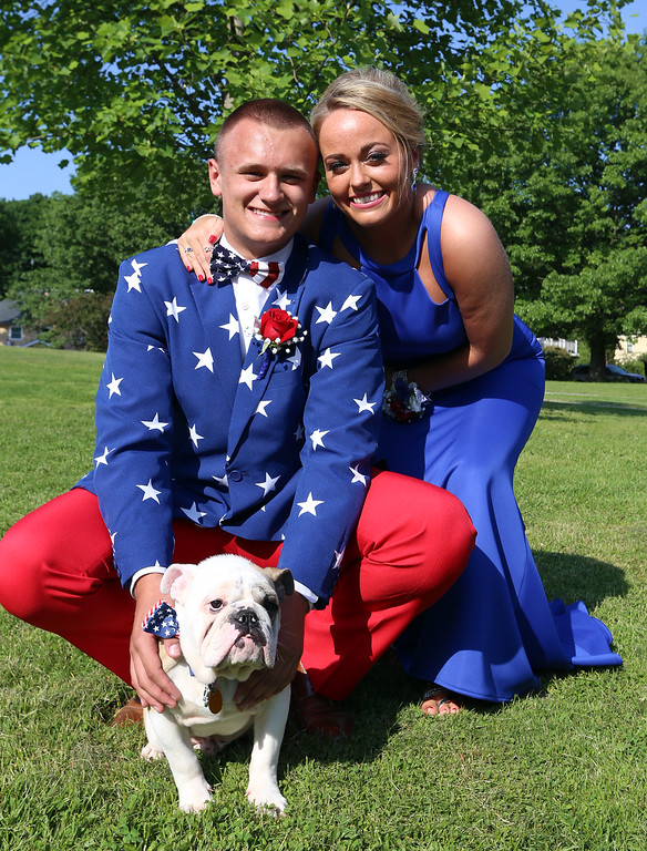 . Lowell High pre-prom gathering at Fort Hill Park. Brendan Broderick and Carley Bostwick, with Bostwick\'s five-month-old bulldog puppy, Gronk. (SUN/Julia Malakie)