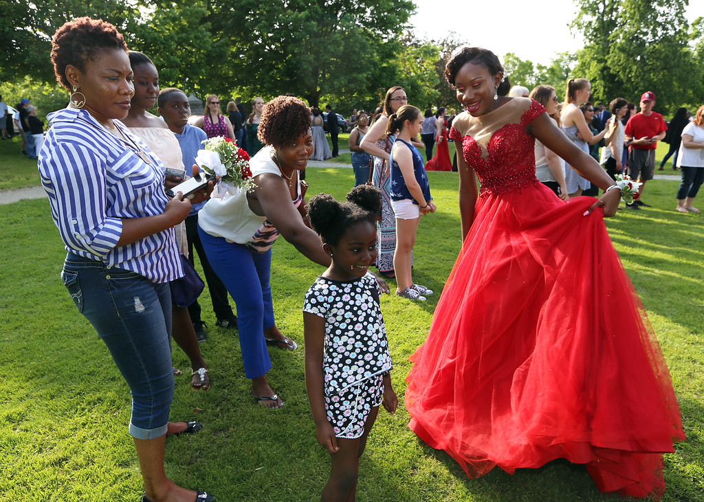 . Lowell High pre-prom gathering at Fort Hill Park. Juliana Oseiowusu, right, with from left, her mother Lawrencia Oseiowusu, cousin Karen Akwaboah, aunt Gloria Akwaboah and cousin Blessing Akwaboah, 4, also of Lowell. (SUN/Julia Malakie)