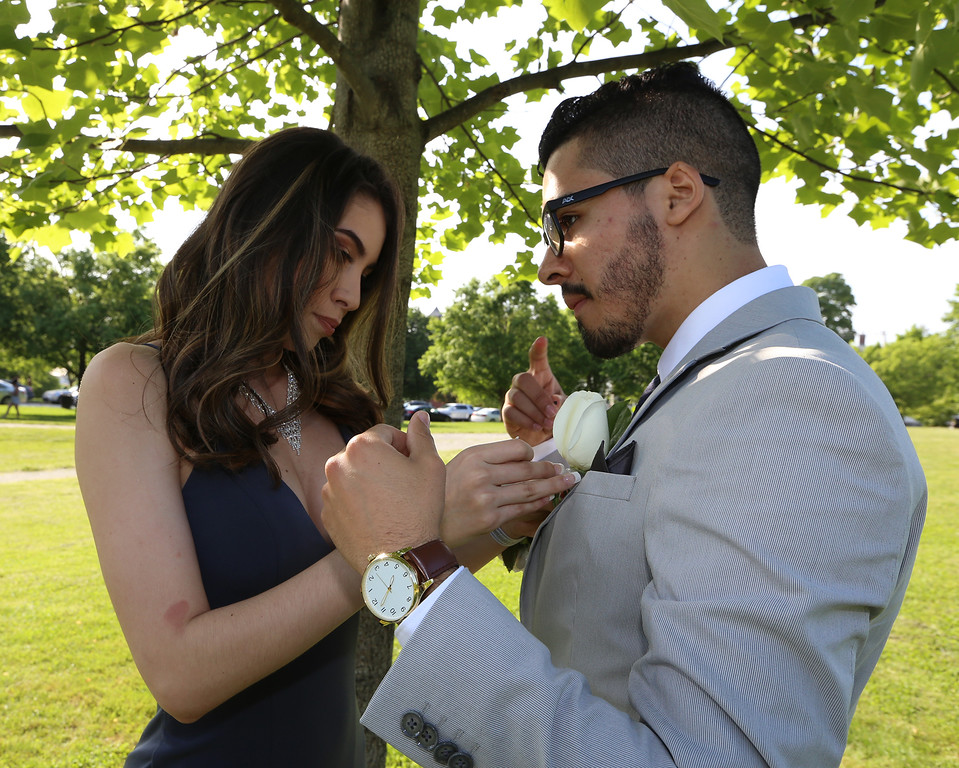 . Lowell High pre-prom gathering at Fort Hill Park. Aneisha Adames and Jorge Giraldo. (SUN/Julia Malakie)