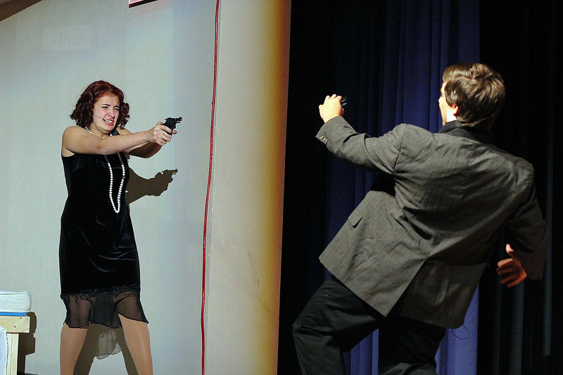 Students at Leominster High School rehearse for the musical Chicago on Thursday afternoon at the school. Deanna Martinez playing Roxie Hart shoots Kyle Davi who was playing Fred Casely during the dress rehearsal. SENTINEL & ENTERPRISE/ JOHN LOVE