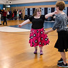 Ellen Harvey and physical education teacher Rhonda Malatos break it down during the Goodbye Lunenburg High Sock Hop on Saturday afternoon. The event marked the last dance that will be held in the building before it is torn down and paid homage to the year the school was built, 1957. SENTINEL & ENTERPRISE / Ashley Green