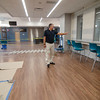 Middle School Principal Tim Santry shows off the cafeteria to Lunenburg residents during a tour of the new middle/high school on Thursday morning. The school is scheduled to open in the fall with the new school year. SENTINEL & ENTERPRISE / Ashley Green