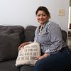 MCC graduate Claudia Aguirre of Lowell, at home.  (SUN/Julia Malakie)