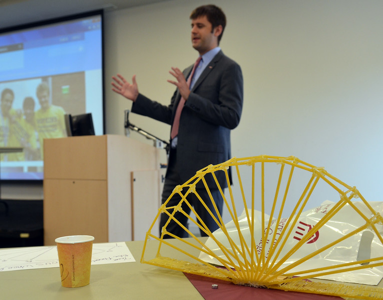 """Justin Land from sponsor Dow Chemical talks to students enrolled in a design and engineering developed by Johns Hopkins University held  Montgomery County Community College that culminated in a  spaghetti bridge building competition .   In the foreground is one of the bridges, named """"Ferrous Wheel"""" by its creators.    Thursday,  July 24, 2014.   Photo by Geoff Patton    Thursday,  July 24, 2014.   PHoto by Geoff Patton"""
