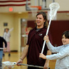 "Jarett Park of the Colorado Mammoth, helps Ben Gotthelf with his passing form during Doug Dombek's gym class.<br /> Colorado Mammoth lacrosse players teach the game at Louisville Elementary as part of the Stick 4 Schools program.<br />  For more photos and a video, go to  <a href=""http://www.dailycamera.com"">http://www.dailycamera.com</a>.<br /> Cliff Grassmick / November 19, 2010"