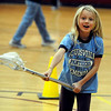 "Sasha Snoeck, a 4th-grader, watches her pass go by her partner during gym class.<br /> Colorado Mammoth lacrosse players teach the game at Louisville Elementary as part of the Stick 4 Schools program.<br />  For more photos and a video, go to  <a href=""http://www.dailycamera.com"">http://www.dailycamera.com</a>.<br /> Cliff Grassmick / November 19, 2010"