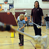 "Jarett Park of the Colorado Mammoth, helps Sasha Snoeck with her passing form during Doug Dombek's gym class.<br /> Colorado Mammoth lacrosse players teach the game at Louisville Elementary as part of the Stick 4 Schools program.<br />  For more photos and a video, go to  <a href=""http://www.dailycamera.com"">http://www.dailycamera.com</a>.<br /> Cliff Grassmick / November 19, 2010"
