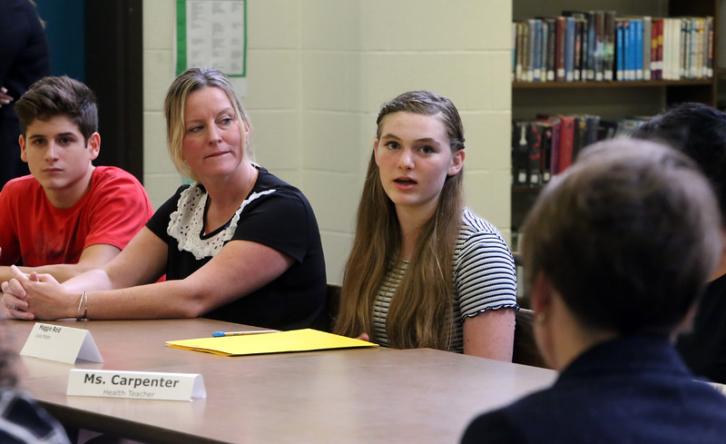 Massachusetts attorney general Maura Healey visits Marshall Middle School in Billerica for round table discussions with middle school students, health teachers, and town officials, about opioids. From left, Locke Middle School 8th grader Connor Gibson, 14, health teacher Heather Tuxbury, and 8th grader Maggie Reid, and Healey. (SUN/Julia Malakie)
