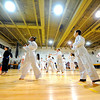 McKay Arts Academy 3rd graders give a Taekwondo demonstration for family and friends during their graduation from the 8-week class under the guidance of Instructor Jihoon Kim of the Leominster U.S. Taekwondo Center, Monday night in Fitchburg.<br /> SENTINEL & ENTERPRISE / BRETT CRAWFORD