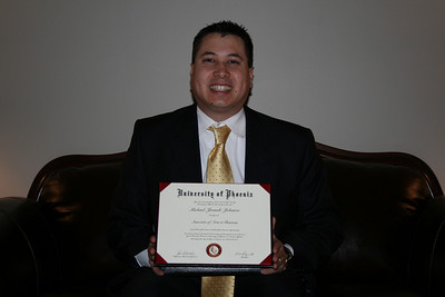Michael holding his 1st college degree!  Associate of Arts in Business from the University of Phoenix.