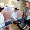 "Greg Lund, left, and  Johannes Thomason-Larsen, both of Southern Hills Middle School, talk to Chef Bradford Heap during the competition.<br /> Area middle schools competed in an Iron Chef- style competition at Casey Middle School in Boulder on Thursday. The winning school will win money for the school and have their recipe used for school lunches.<br /> For a video photos of the competition. go to  <a href=""http://www.dailycamera.com"">http://www.dailycamera.com</a>.<br /> Cliff Grassmick / March 22, 2012"