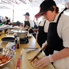 "Noah Zimmerman, right, of the Casey  Paw-crastination Team, cuts up chicken for their entree.<br /> Area middle schools competed in an Iron Chef- style competition at Casey Middle School in Boulder on Thursday. The winning school will win money for the school and have their recipe used for school lunches.<br /> For a video and photos of the competition. go to  <a href=""http://www.dailycamera.com"">http://www.dailycamera.com</a>.<br /> Cliff Grassmick / March 22, 2012"