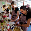 "Nickie Timson, center, and Riley Merrill, of the Aspen Creek Middle School in Broomfield, prepare a fruit salad.<br /> Area middle schools competed in an Iron Chef- style competition at Casey Middle School in Boulder on Thursday. The winning school will win money for the school and have their recipe used for school lunches.<br /> For a video and photos of the competition. go to  <a href=""http://www.dailycamera.com"">http://www.dailycamera.com</a>.<br /> Cliff Grassmick / March 22, 2012"