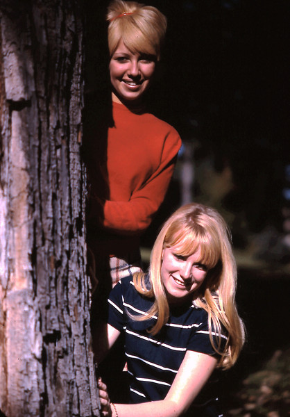 Unknown Student in Red Sweater; Betty Jerousek in Striped Dress