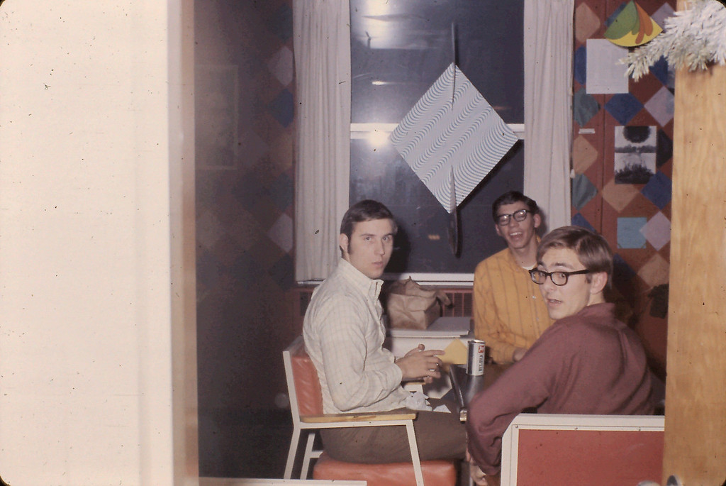 Doug Simler (left size of photo, facing camera), Randy Martz (center of photo facing camera), and Hal Lupinek (right side of photo turning to face the camera)
