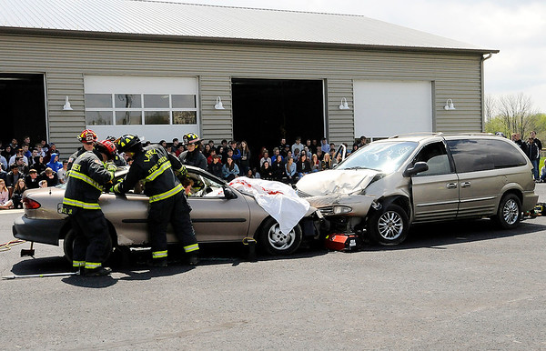 Don Knight   The Herald Bulletin<br /> About 200 students from Lapel High School watch fire fighters  work to extricate a driver during a mock accident on Friday.