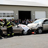 Don Knight | The Herald Bulletin<br /> About 200 students from Lapel High School watch fire fighters  work to extricate a driver during a mock accident on Friday.