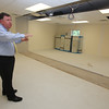 Chelmford superintendent of schools Jay Lyan gives a tour of the new permanent modular classrooms being built at the Center Elementary School.  (SUN/Julia Malakie)