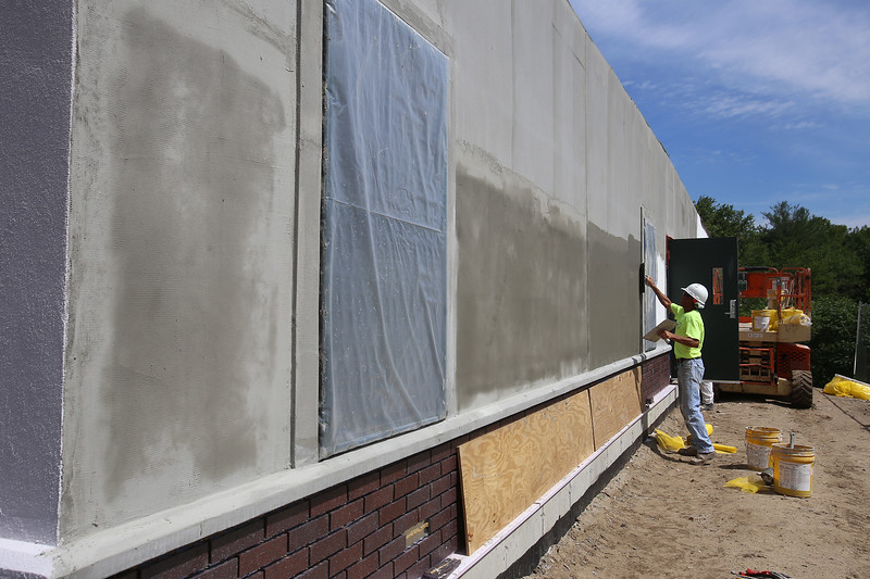 New permanent modular classrooms under construction at Byam Elementary School, in a separate building. Michael Wirtz of Templeton, with V & S Finishing, applies synthetic stucco to exterior. (SUN/Julia Malakie)