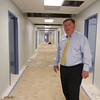 Chelmford superintendent of schools Jay Lyan gives a tour of the new permanent modular classrooms being built at Byam Elementary School. Six classrooms are off this corridor, in a separate building. (SUN/Julia Malakie)