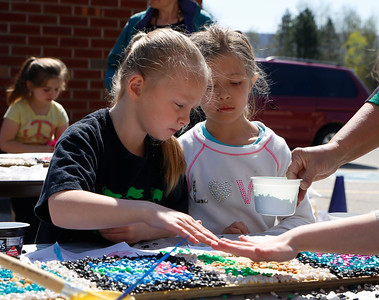 Molly Stark Students create mosaics for school garden. 051116