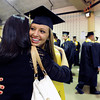 "Monarch High School's Bailee Jensen hugs Stephanie Kirby at the start of the Monarch High School graduation ceremony on Friday, May, 18, at the Coors Event Center on the University of Colorado campus in Boulder. For more photos of the graduation go to  <a href=""http://www.dailycamera.com"">http://www.dailycamera.com</a><br /> Jeremy Papasso/ Camera"