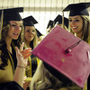 "Monarch High School's Ashton Patrick, left, Lexie Pike, center, and Natalie Munio laugh together at the start of the Monarch High School graduation ceremony on Friday, May, 18, at the Coors Event Center on the University of Colorado campus in Boulder. For more photos of the graduation go to  <a href=""http://www.dailycamera.com"">http://www.dailycamera.com</a><br /> Jeremy Papasso/ Camera"