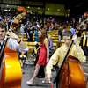"Monarch High School band members Alex Ross, left, and Chris Miller play the standup bass during the Monarch High School graduation ceremony on Friday, May, 18, at the Coors Event Center on the University of Colorado campus in Boulder. For more photos of the graduation go to  <a href=""http://www.dailycamera.com"">http://www.dailycamera.com</a><br /> Jeremy Papasso/ Camera"