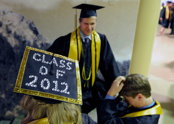 "Monarch High School's Breanna Macdonald, left, Gus Sawicki and Drew McCaulay talk together during the Monarch High School graduation ceremony on Friday, May, 18, at the Coors Event Center on the University of Colorado campus in Boulder. For more photos of the graduation go to  <a href=""http://www.dailycamera.com"">http://www.dailycamera.com</a><br /> Jeremy Papasso/ Camera"