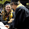 "Monarch High School's Veronica Bird laughs with Tanner Cahoon after receiving their diplomas during the Monarch High School graduation ceremony on Friday, May, 18, at the Coors Event Center on the University of Colorado campus in Boulder. For more photos of the graduation go to  <a href=""http://www.dailycamera.com"">http://www.dailycamera.com</a><br /> Jeremy Papasso/ Camera"