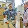 Montachusett Regional Vocational Technical School Principal Tom Browne talks with Joe Bulger the cabinet making teacher at the schiool. SENTINEL& ENTERPRISE/JOHN LOVE