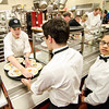 Students line up to fill their trays and serve dinner during the 29th annual Superintendent's Dinner, also celebrating Monty Tech's 50th anniversary, on April 13. SENTINEL & ENTERPRISE / Ashley Green