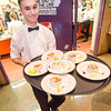 Ian Bickford, 17, serves dinner during the 29th annual Superintendent's Dinner, also celebrating Monty Tech's 50th anniversary, on April 13. SENTINEL & ENTERPRISE / Ashley Green
