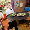 Jourdan Garny, 16, serves dinner during the 29th annual Superintendent's Dinner, also celebrating Monty Tech's 50th anniversary, on April 13. SENTINEL & ENTERPRISE / Ashley Green