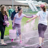 Julia Cormier, Sarah Aponte and Samantha Adam douse walkers in color during the Colorful Change at Monty Tech on Saturday, April 23. The event was created by students in the Youth Venture program and the proceeds were to benefit local children in foster care. SENTINEL & ENTERPRISE / Ashley Green