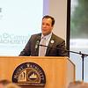 Gardner Mayor Mark Hawke speaks during the Chamber of Commerce breakfast honoring outgoing MWCC President Daniel Asquino on Friday morning at the school. SENTINEL & ENTERPRISE / Ashley Green
