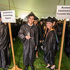 Junior Argollo, of Leominster, and Amanda Baldino, of Barre, await the beginning of the graduation ceremony at Mount Wachusett Community College on Wednesday evening. SENTINEL & ENTERPRISE / Ashley Green