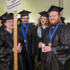 Ian Cook, Thomas Hill, Tatjana James and Thomas Girard await the start of the graduation ceremony at Mount Wachusett Community College on Wednesday evening. SENTINEL & ENTERPRISE / Ashley Green