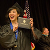 Monica Kwan, of Fitchburg, excitedly shows off her diploma during the 51st commencement ceremony at Mount Wachusett Community College on Wednesday evening. SENTINEL & ENTERPRISE / Ashley Green