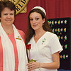 Veronica Alexander, of Townsend, (right) receives her nursing pin from Loretta Rock (left)  at the Mount Wachusett Community College nurses pinning ceremony held on Thursday evening. SENTINEL & ENTERPRISE / Ashley Green