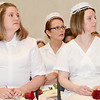 Jennifer Benoit, of Fitchburg, (left) and Courtney Benoit fv (left) listen to speakers at the Mount Wachusett Community College nurses pinning ceremony held on Thursday evening. SENTINEL & ENTERPRISE / Ashley Green