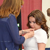 Caitlin Cormier, of Leominster, receives her nursing pin from Robin Elkins during the Mount Wachusett Community College nurses pinning ceremony held on Thursday evening. SENTINEL & ENTERPRISE / Ashley Green